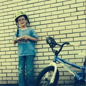 Photo of a boy with his bicycle