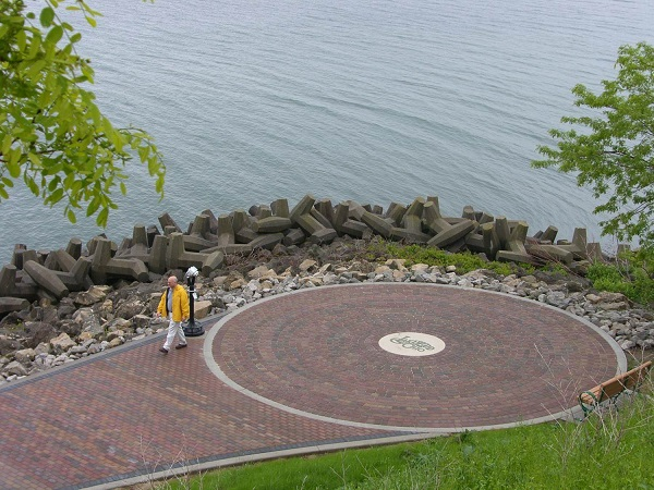 Image of man in yellow jacket taking a stroll at Lakewood Park's lookout point