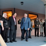 Image of Mayor Summers cutting the ribbon on a renovating 117 year old home on Grace