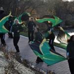 Photo of St. Edwards marching band flag line at new Solstice Steps celebration