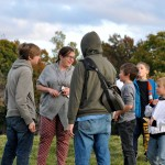 Photo of H20 director Emmie Hutchinson speaking with her children and volunteers