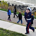 Photo of boy in uniform smiling at Solstice Steps celebration