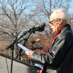 Photo of Bill Knittel, the city's poet laureate, reading a special poem for Veteran's Day in 2015