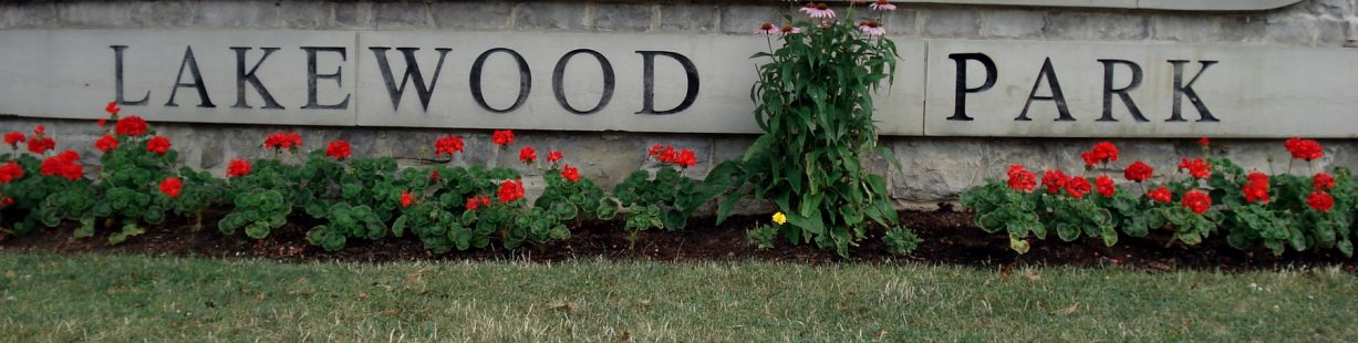 Image of Lakewood Park Sign adorned with Flowers