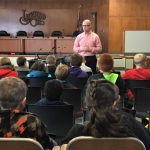 Photo of Councilman John Litten speaking to students from Lincoln Elementary School